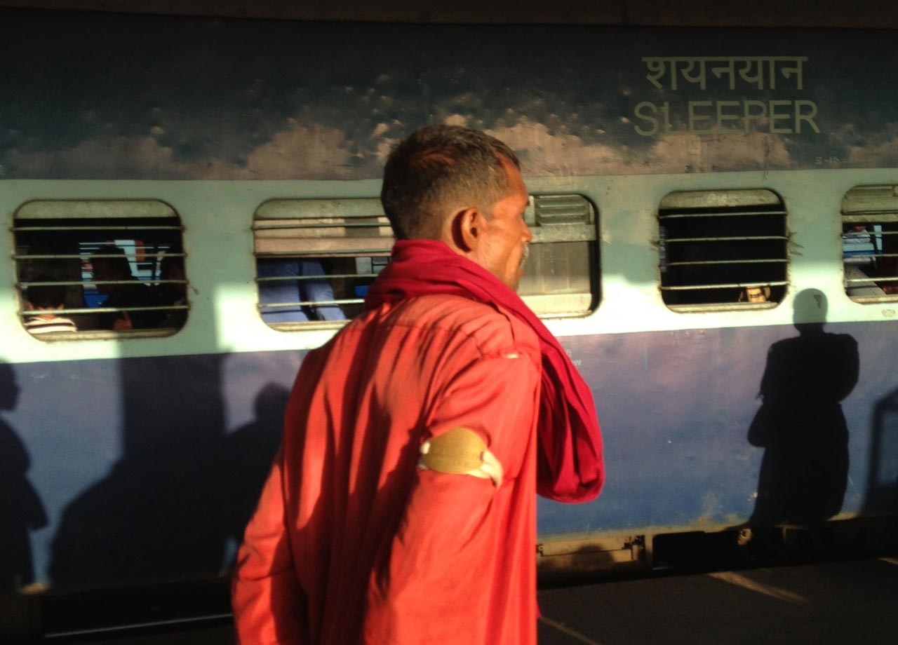 colourful india station porters red jacket