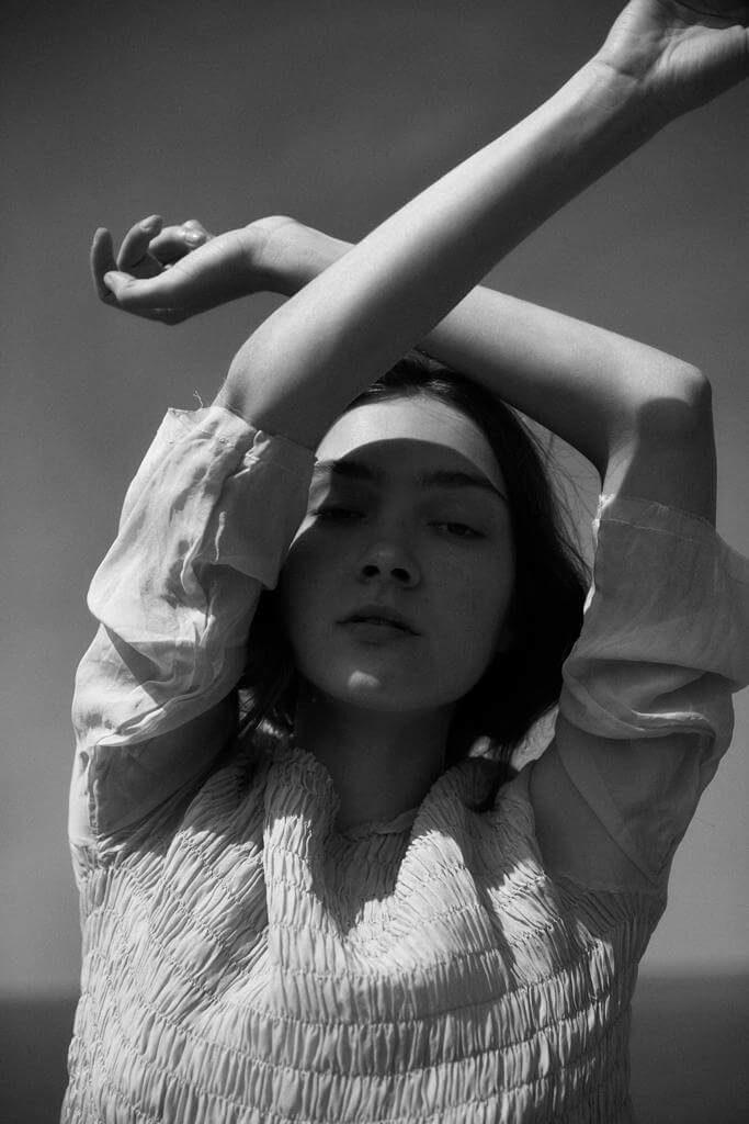 model wearing sula ss19 silk sweep dress.